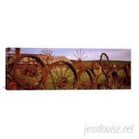 East Urban Home 'Old Barn with a Fence Made of Wheels, Palouse, Washington State' Photographic Print on Canvas EUBN9581