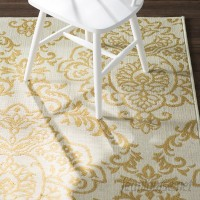 Charlton Home Carriage Hill Ivory/Gold Indoor/Outdoor Area Rug CHLH2955
